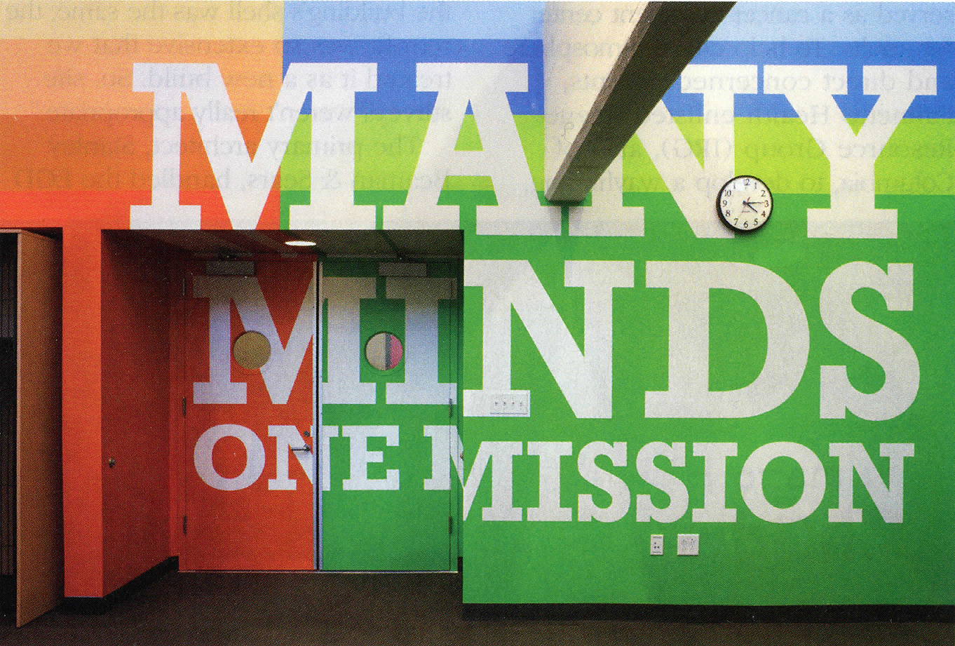 Many Minds - What we like about this sign: This door doesn't limited the ability of this sign to make an impression. Instead it adds to the 3-dimensional capability of the sign.