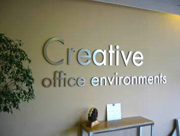Creative - What we like about this sign: Simple, classic letters add an up-scale feel to this reception area.