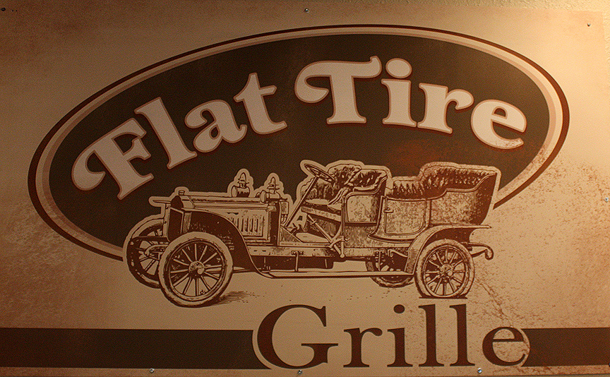 Flat Tire Grille - What we like about this sign: Design conveys the feel and atmosphere of this restaurant.